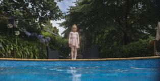 DISCLOSURE- Natasha staring down at the adults in the swimming pool